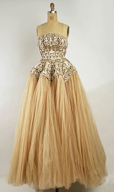 Ensemble.  House of Balenciaga   Designer: Cristobal Balenciaga (Spanish, 1895–1972). Department Store:  Bergdorf Goodman. Date: fall/winter 1950–51. Culture: French. Medium: silk, metallic, glass.