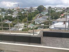 Edge of concrete deck parapet internal gutter.  Blockwork wall with plastered finish (near)