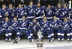 Steven Stamkos, first row center, and teammates relax for a fun picture with the East championship trophy Wednesday.
