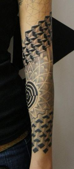 Tattoo of a Star radiating Sacred Geometry Symbols networked on a Girl's Forearm & Elbow