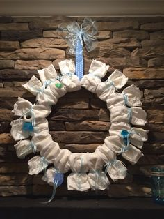 DIY baby shower ideas!  Diaper wreath for mantle/fireplace. #boy #girl…