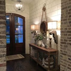 Shiplap, unique mirror design and arched doors. Look at the light fixture too!