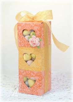 I made a similar favor box set. http://scrappincatscreativeendeavors.blogspot.com/2012/03/stacked-favor-boxes.html