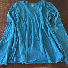 XL Blue Lightweight Long Sleeve Maurice's Tee Lightweight blue XL long sleeved tee from Maurice's. This top is perfect for layering. Top is in great condition. Any questions, need more photos, feel free to ask!  Will consider reasonable offers. I don't trade, please don't ask. Maurices Tops Tees - Long Sleeve