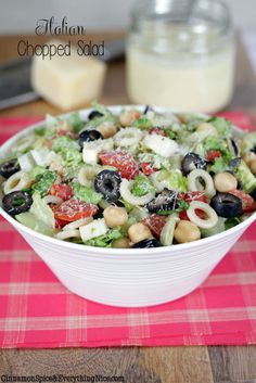 Italian Chopped Salad- A BIG chopped salad loaded with salami mozzarella artichoke hearts chickpeas cucumber plum tomatoes red onion little pasta rings and romaine lettuce tossed in a tangy Parmesan vinaigrette. I Love Food, Good Food, Yummy Food, Italian Chopped Salad, Italian Salad, Italian Pasta, Salada Light, Great Recipes, Favorite Recipes