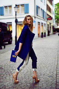 Royal blue coat, blue and white pants, blue clutch, and nude heels