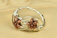 Wire Wrapped Ring- Sterling Silver Filled Wire with Two Copper Tone Flower Bead - Any Size - Size 4, 5, 6, 7, 8, 9, 10, 11, 12, 13, 14 on Etsy, $16.00