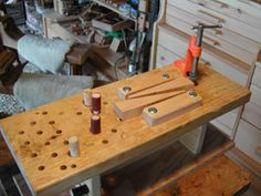 How to Build a Tabletop Woodworking Mini-Bench by Sue Robishaw for workshop projects large or small with custom vises and jigs to fit individual homestead or woodshop jobs. Garage Woodworking Shop Ideas, Woodworking Assembly Table, Woodworking Bench Plans, Woodworking For Kids, Woodworking Workshop, Woodworking Projects, Woodworking Techniques, Woodworking Furniture, Tool Bench