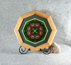 Monarch Butterfly sacred geometry mandala kaleidoscope fine art framed photograph titled Monarch Melody. <p>Monarch Butterfly framed kaleidoscope photo. The frame is a 13.5x13.5 octagon hand crafted from oak with a natural finish. Photo is double matted, outside mat is dark green and inner mat is a pale yellow. The back is protected with a dust cover. The actual photograph...