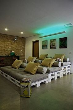 Stacked Pallet Seating for Home Cinema - build with twin sized box springs and mattresses using body pillows for backrests convert to king sleeper for guest room use by putting front mattress on top of middle row