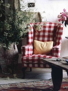 From CozyCanadianCottage.blogspot.ca ... Red and white buffalo check wingback chair.