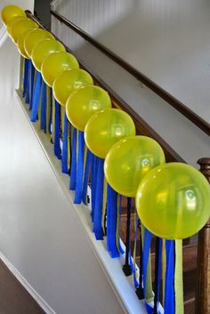 More blue and yellow party decor for a minion party.  Streamers hanging from the banister, with balloons lining.  Click or visit fabeveryday.com for more photos and details from this Despicable Me Minions themed birthday party.
