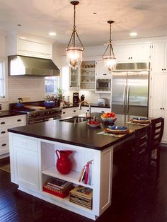 I absolutely LOVE this!  I have a lot of cookbooks but nowhere in the kitchen to store them.  I love how there is so much surface area to work with and the sink on the island is always something I have wanted.  I love that kiddos can sit and chat while I cook and not be in my way.  This is an all over perfect kitchen for me.