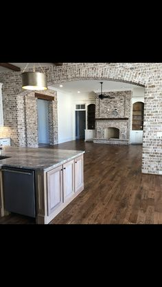 """The brick arch will """"separate"""" the kitchen and dining rooms. The fireplace in this picture will be replaced with a floor-to-ceiling, dual-sided fireplace (see other pin) House Design, New Homes, Rustic House, Building A House, House Plans, House Interior, Home Remodeling, Home, Brick Arch"""