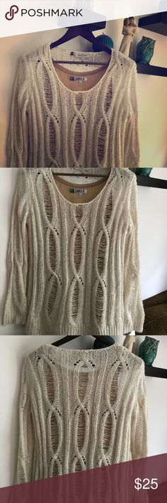 Stunning shimmering tank and sweater set! Worn 1x! Stunning shimmering Jennifer Lopez tank and sweater set! WORN ONE TIME! The tank is shimmery gold and the sweater is a shimmery cream and gold combo! Perfect for any special occasion! *tank is L, sweater is XL, but they are a good layering match! ✨ Jennifer Lopez Sweaters
