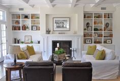 neutral living room with pops of color...like the arrangement of furniture