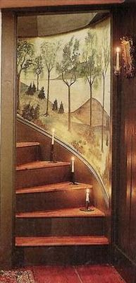 Got country style down to a fine art...Primitive painted wall mural of rolling country hills and trees accompanies a winding timber staircase painted in antique red...