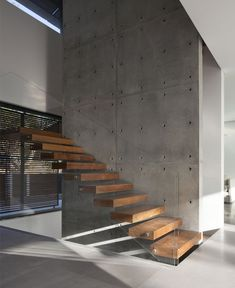 Family Residence in an Urban Environment family residence concrete wall staircase