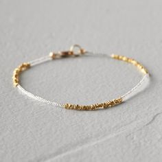"Glittering gold and seed beads form a simple pattern on this delicate bracelet, each one hand-crafted in Brooklyn by Debbie Fisher Jewelry.- 14k gold vermeil, seed beads, 14k gold fill clasp- Lobster clasp closure- Lead free- 3.2"" diameter when clasped- Handmade in the USA0.2""W, 6.5""L"