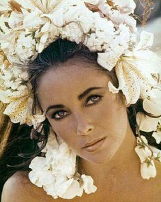 The beautiful Elizabeth Taylor, love the beautiful flowers on her head.