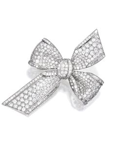 PLATINUM AND DIAMOND BROOCH, TIFFANY & CO. Designed as a bow set with numerous round, square and triangular-cut diamonds weighing approximately 9.40 carats, signed Tiffany & Co. With signed box.