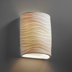 The Porcelain Waves Wall Sconce features a semi-cylindrical form with a translucent porcelain diffuser. One 13 watt 120 volt 1000 lumens LED module is included. Glass Pendant Light, Glass Pendants, Lake Decor, Lighting Techniques, Beach House Decor, Wall Sconces, Diffuser, Wall Lights, Porcelain