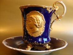 Huge cobalt and gold porcelain cup and saucer set with medallion portraits of the Tzar and Tzaritza on each side of the cup by Meissen, Germany, 19th Cent.