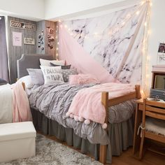 Pink and gray dorm room