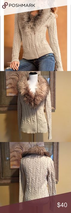 """SALE Boston Proper Cable Faux Fur Cardigan This is a gorgeous faux fur cable knit cardigan sweater from Boston Proper.  It features a luxurious, removable faux-fur collar, silver tone single front asymmetrical zip with ribbed cuffs & hem.  Hit the slopes in this versatile cardigan or simply wear around town with straight legged denim & boots.  It's made of an acrylic/nylon/wool blend & it measures 23"""" from center back to hem, 18"""" across the front & the sleeves are 24"""" long.  Worn just once…"""