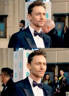 #TomHiddleston poses for photographers on the red carpet of EE BAFTAs 2015.