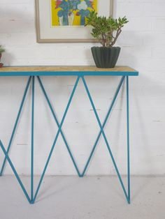Sculptural metal sideboard designed by &New