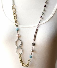 """Mixed metal chain, rhinestone, crystals and hand wrapped beads. Length: 31"""""""