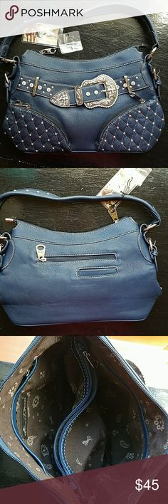 """Montana West Purse Re-Posh. I absolutely Love this purse..but I realize that I carry too much stuff for this purse..my loss your gain. Brand New with tags. Dark Blue. Width is 13"""" at.the bottom, the opening is 11"""". Height is 9"""" without the handles. Bottom is 4.5"""" across. Divider pocket inside..plus 3 other pockets.  On the outside..back has 2 pockets..and the from has 2 pockets. Montana West Bags Shoulder Bags"""
