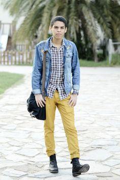 Shop this look on Lookastic:  http://lookastic.com/men/looks/longsleeve-shirt-messenger-bag-chinos-chelsea-boots-denim-jacket/4926  — Brown Plaid Long Sleeve Shirt  — Black Canvas Messenger Bag  — Mustard Chinos  — Black Leather Chelsea Boots  — Light Blue Denim Jacket