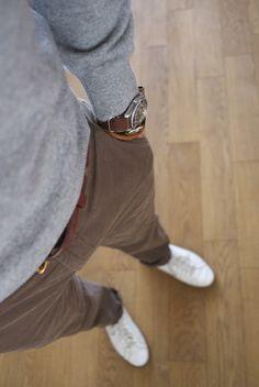 Gray sweater and light chocolate slacks.