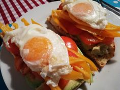 Home made toast with eggs, avocado, tomato, peppers and cheese