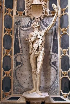 """Displayed in the Saint-Étienne church in France is the figure of René de Chalon, Prince of Orange. The prince died at the young age of 25 during the siege of Saint-Dizier in 1544.  Rather then memorialize him in the standard hero form, his wife requested (or René himself requested, or possibly both) that he be shown as """"not a standard figure but a life-size skeleton with strips of dried skin flapping over a hollow carcass, whose right hand clutches at the empty rib cage while the left hand…"""