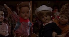 Dolls (1987)  Dir: Stuart Gordon Stars: Ian Patrick Williams, Carolyn Purdy-Gordon, Carrie Lorraine, Guy Rolfe  A group of people stop by a mansion during a storm and discover two magical toy makers, and their haunted collection of dolls.  Watch here: https://www.youtube.com/watch?v=qXLTDdu3B0g
