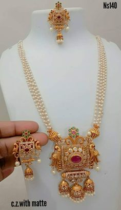 temple jewelry available at Arshi's. for bookings whatsapp on worldwide shipping. Gold Earrings Designs, Gold Jewellery Design, Bead Jewellery, Temple Jewellery, Gold Jewelry, Gold Designs, Mehndi Designs, Necklace Designs, Luxury Jewelry