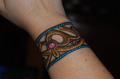 The baroque design goes all the way around the wrist -- beautiful colors and just like jewelry.