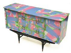 Primo Sideboard  1960's sideboard designed and manufactured in Italy. Hand-painted cabinet finished in a freeform abstract design. Four matching drawers and two matching cupboards with decorative brass handles and detail. Ebonised leg frame.