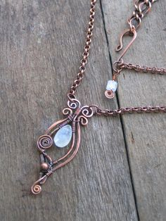 Rainbow Moonstone and Copper Wire Sculpted Necklace. Stephanie Taylor via Etsy. - pretty - http://www.diyhomeproject.net/rainbow-moonstone-and-copper-wire-sculpted-necklace-stephanie-taylor-via-etsy-pretty