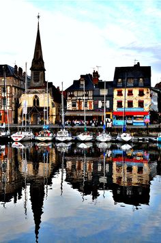 Reflections in the Water, Honfleur Harbor, a town in Normandy, France known for artworks by Claude Monet and other Impressionist painters - the birthplace of Impressionism