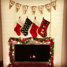 my first Christmas mantle fireplace decor :0) used wrapping paper for the sign. cut them in triangles. printed out letters. stringed them all together with a leather lace.