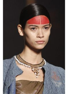 Tribal necklaces at Vivienne Westwood  Vivienne Westwood Fall/Winter 2014-2015 was the perfect synthesis of Victorian and Inca inspiration and the collection's accessories brought together diamond period pieces with colored beads, for a more hand-crafted look.