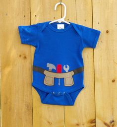 This super soft cotton onesie appliqued with a faux suede tool belt is sure to be a hit with your little do it yourselfer. The inside of the