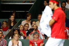 Roger's daughters look on.
