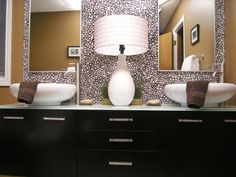 I like the idea of double sinks, I love the colors (blacks,grays,browns and tans) it makes the bathroom warm and inviting.. I love the crazy wallpaper (it reminds me of pok-a-dots<3) and faucets are chic ..love it!!!