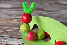 cute hungry caterpillar craft with pipe cleaners and wood beads.  perfect for tots.