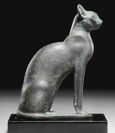 AN EGYPTIAN BRONZE CAT   THIRD INTERMEDIATE PERIOD-PTOLEMAIC PERIOD, CIRCA 1069-30 B.C.